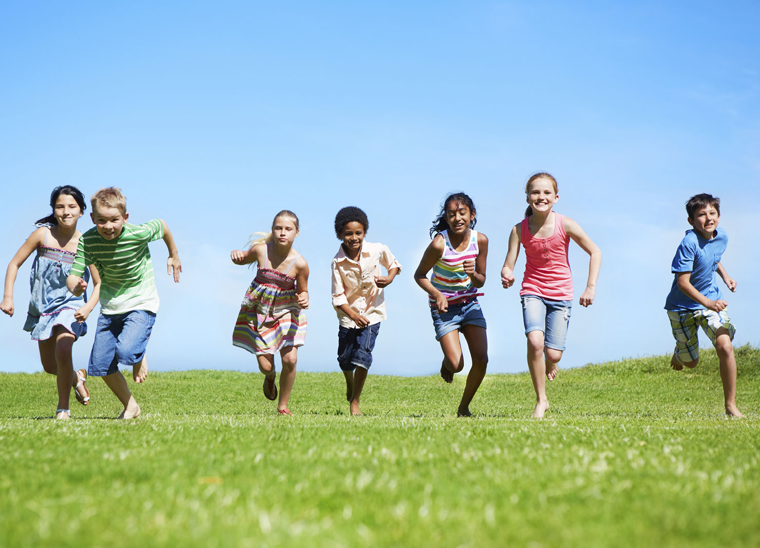 A group of children running outside(exercise) for a healthy living